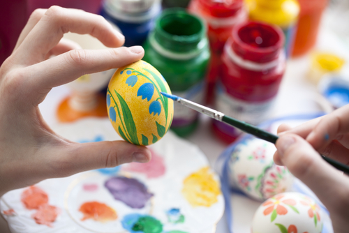Painting Easter eggs at a birthday party.