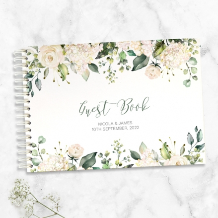 white-flower-garland-wedding-guest-book